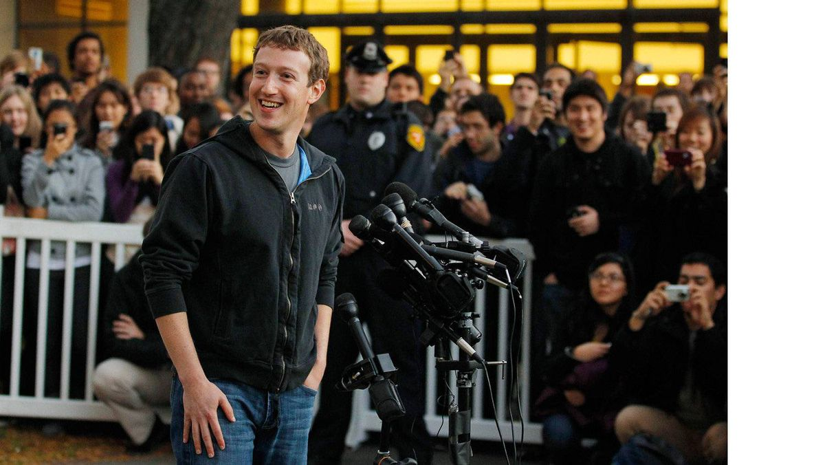 Facebook founder and CEO Mark Zuckerberg speaks to reporters at Harvard University in Cambridge, Mass., in this Nov. 7, 2011 file photo. The social network filed an initial public offering prospectus on Feb. 1, 2012, with an eye toward raising $5-billion.