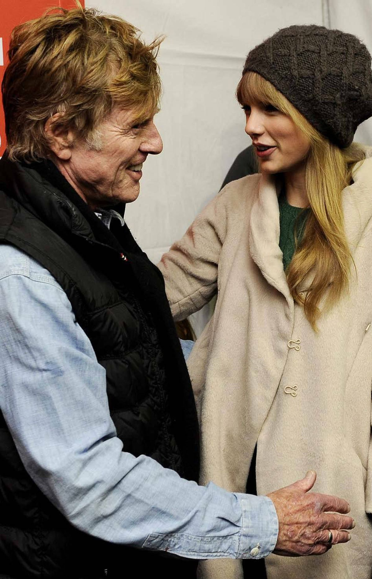 Robert Redford wonders who he should fire for inviting Taylor Swift to the Sundance Film Festival on Friday.