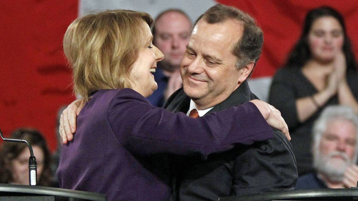 Toronto MP Peggy Nash and former party president Brian Topp embrace after the NDP leadership debate in Ottawa on Dec. 4, 2011.