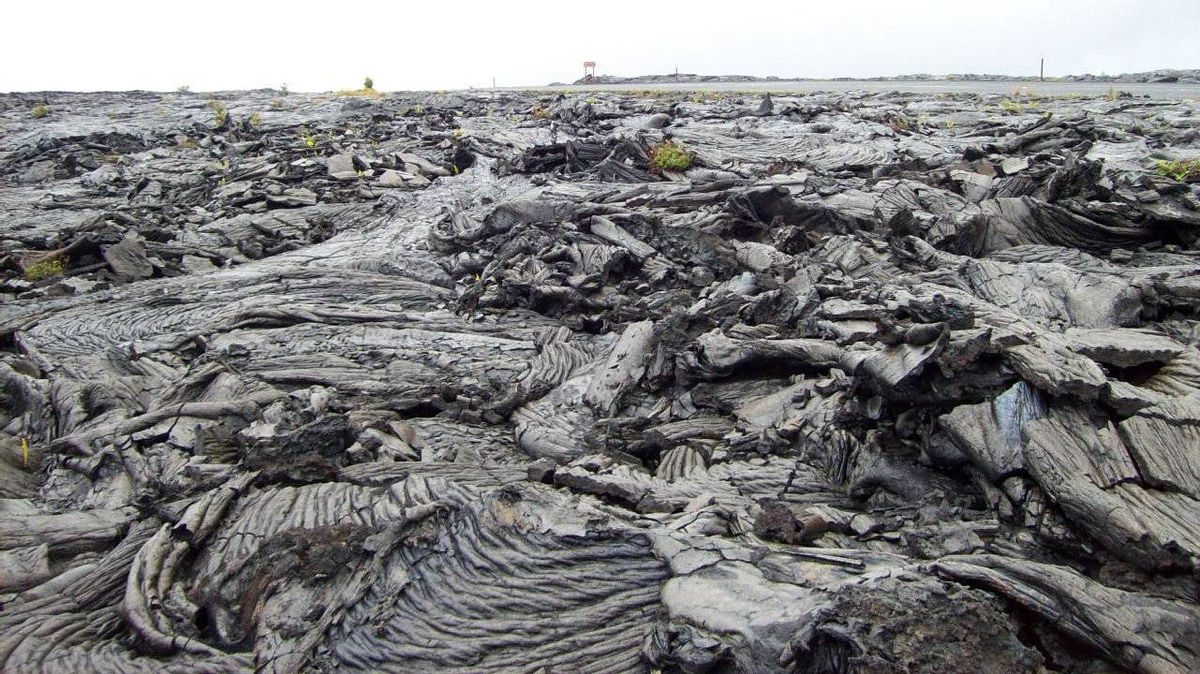The swirls and puddles of hardend lava create a bleak landscape but, hundreds of years later, it will be covered by lush tropical growth.