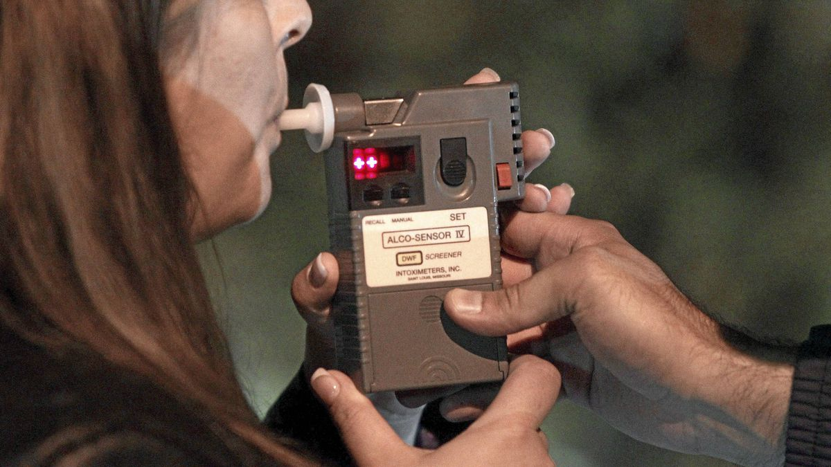 An RCMP officer performs a breathalyzer test on a driver during a roadside check in Surrey, B.C., just before midnight on Friday September 24, 2010. The woman blew .05 and received an immediate three-day driving ban and a $200 fine. Strict new drunk-driving laws, now considered to be the toughest in the country, took effect in B.C. this week.