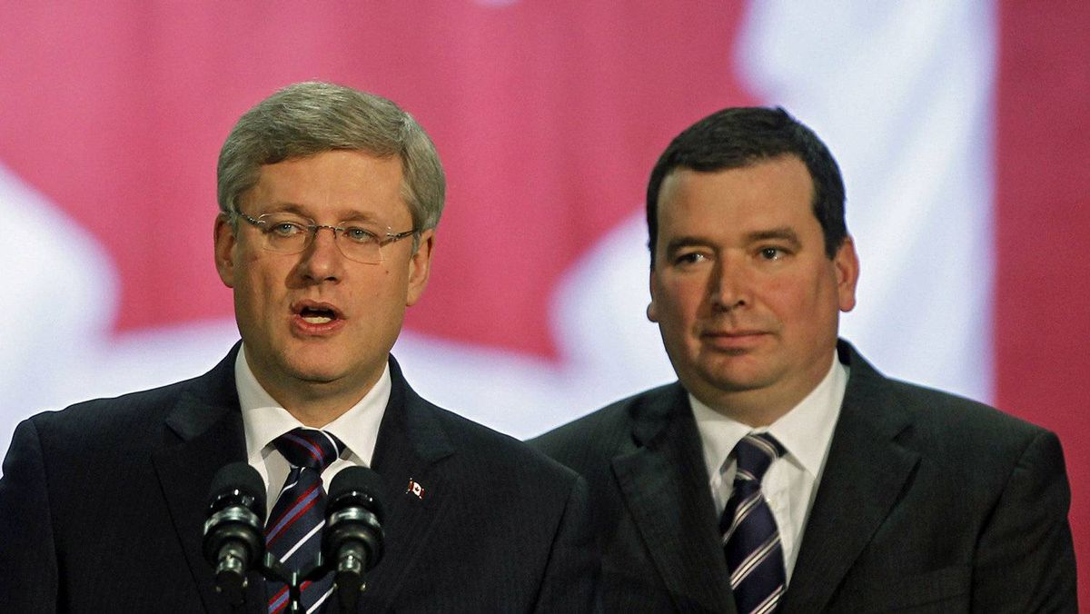 Prime Minister Stephen Harper and Minister of Natural Resources Christian Paradis speak to workers in Thetford Mines, Que., on Dec. 13, 2010.