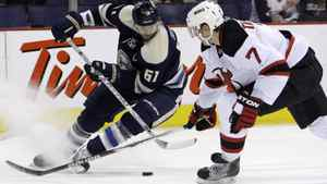 Columbus Blue Jackets' Rick Nash, left, tries to control the puck as New Jersey Devils' Henrik Tallinder, of Sweden, defends during the second period of an NHL hockey game Sunday, March 20, 2011, in Columbus, Ohio. The Devils won 3-0. (AP Photo/Jay LaPrete)