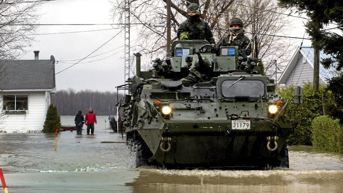 Soldiers from the 22nd Regiment, known as the VanDoos, drive their light armoured vehicle through the flooded streets of Saint Blaise, Que., May 5, 2011.