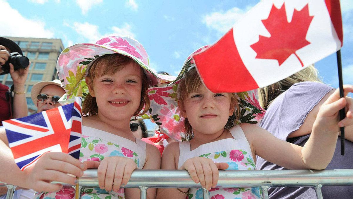Young Royal watchers await the arrival of the Duke and Duchess of Cambridge at the War Memorial in Ottawa, June 30, 2011.