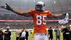 B.C. Lions Shawn Gore cheers from the bench during the second half of their CFL Western Conference Final football game against the Edmonton Eskimos in Vancouver, British Columbia, November 20, 2011.