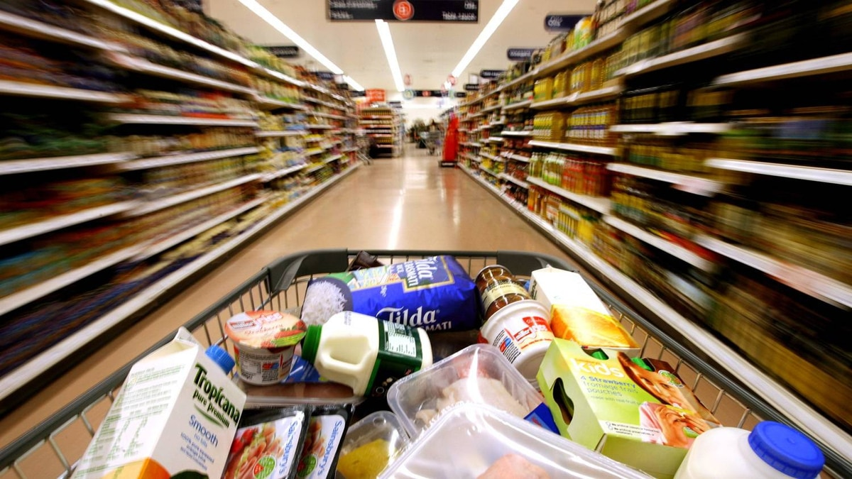 A customer pushes a grocery cart through the food aisles at a Sainsbury's supermarket, in London Colney, U.K., on Friday, Feb. 29, 2008.