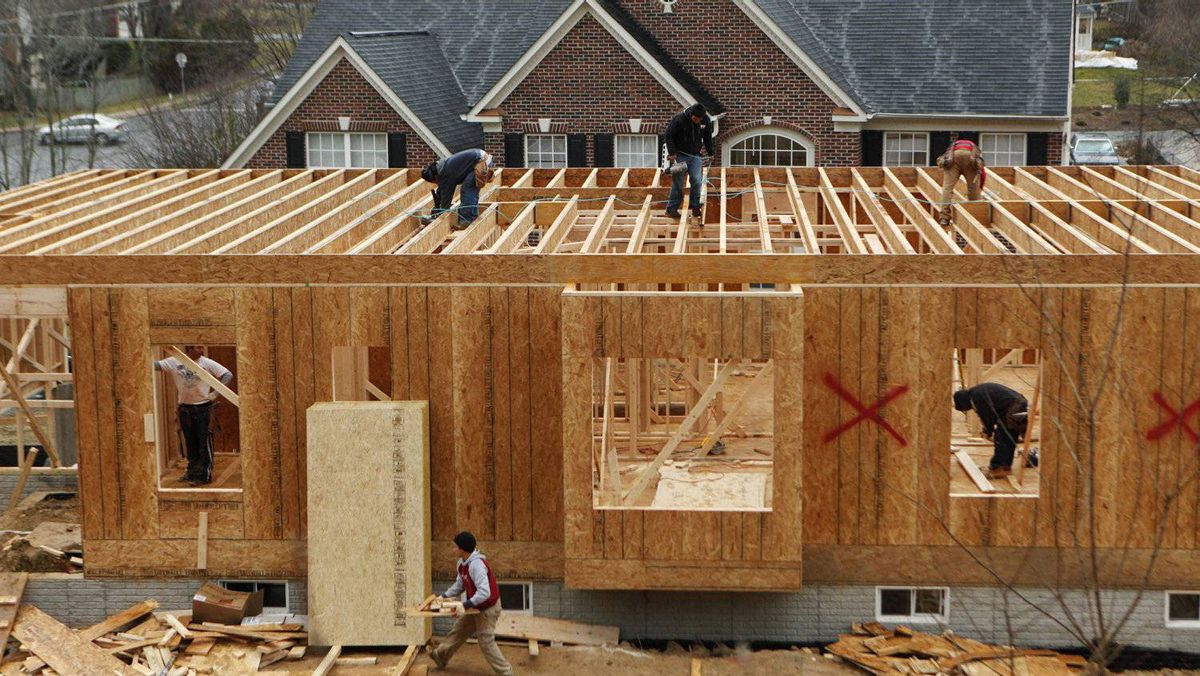 Workers build a new house in Alexandria, Virginia February 16, 2012.