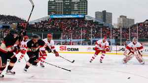 Patrick Kane #88 and Jonathan Toews #19 of the Chicago Blackhawks chase down the puck against the Detroit Red Wings during the NHL Winter Classic at Wrigley Field on January 1, 2009 in Chicago, Illinois. (Photo by Jamie Squire/Getty Images)