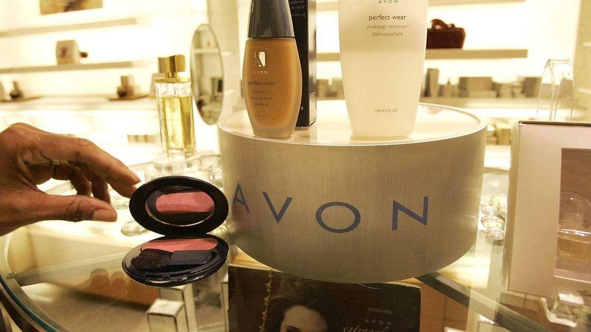 In this file photo, a saleswoman, who did not give her name, places items for a picture on display in an Avon store in New York.