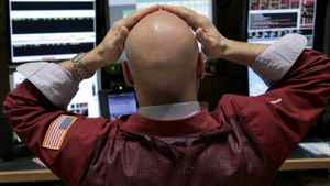 A trader studies monitors on the floor at the New York Stock Exchange in New York, Tuesday, March 6, 2012