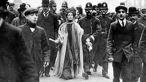 Emmeline Pankhurst, who went from pacifist to ardent hawk, is seen being arrested in 1908 during a suffragette march in Manchester
