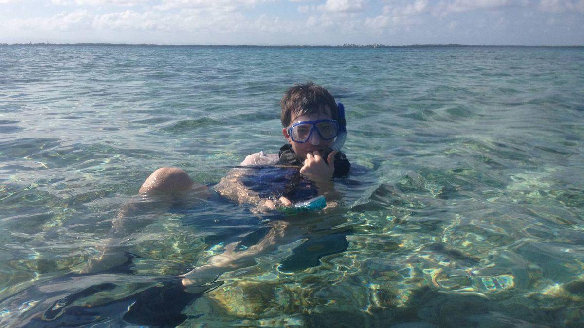 My travel buddy, Noah Vardon, snorkelling on Tobacco Caye