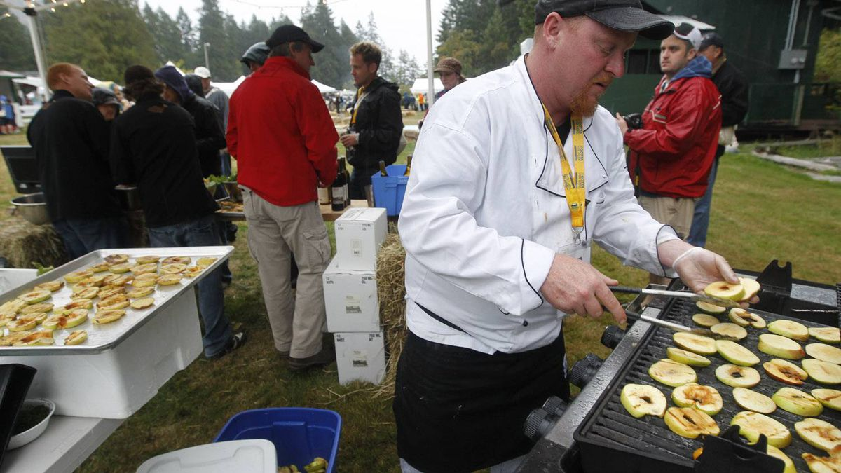 Fisherman Corey Erikson grills apples.