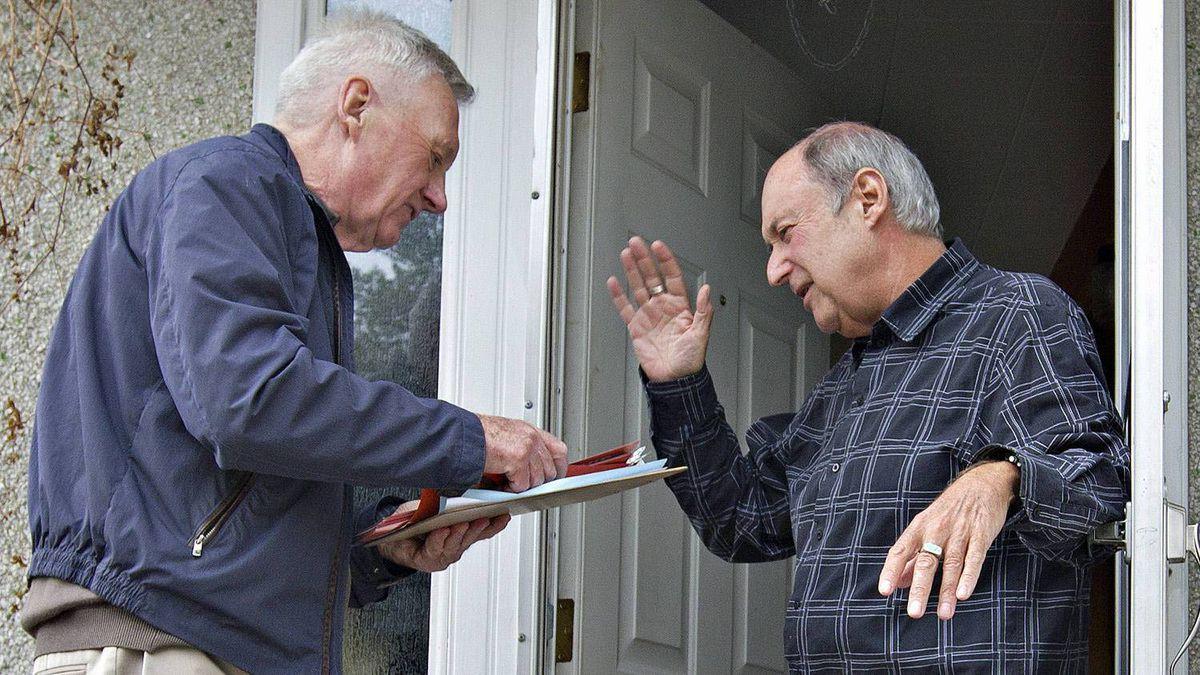NDP candidate Ray Martin talks with Edmonton resident Alan Kellogg on April 25, 2011.