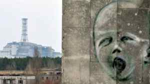 A graffiti is pictured on a wall in the ghost city of Pripyat near the fourth nuclear reactor (background) at the former Chernobyl Nuclear power plant, site of the world's worst nuclear disaster, on April 4, 2011.