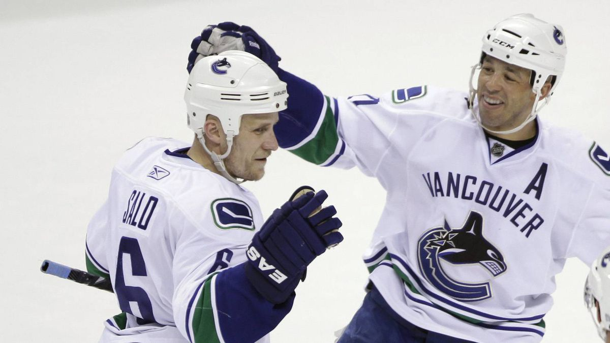 Vancouver Canucks defenceman Sami Salo (6), of Finland, is congratulated by centre Manny Malhotra, right, after scoring against the San Jose Sharks in the first period of an NHL hockey game in San Jose, Calif., Thursday, March 10, 2011.