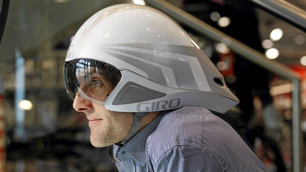Nick Davie poses with a Giro bike helmet at Sigma Sport store in London, United Kingdom on March 14, 2012.