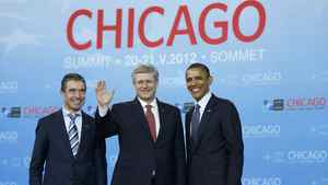 U.S. President Barack Obama (R) and NATO Secretary-General Anders Fogh Rasmussen (L) welcome Prime Minister of Canada Stephen Harper at the NATO Summit in Chicago, May 20, 2012.