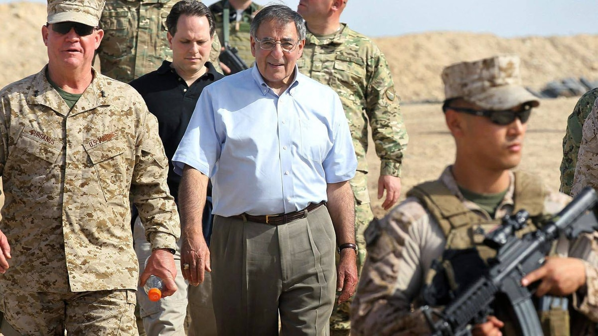 U.S. Defense Secretary Leon Panetta leaves after visiting with American troops at Forward Operating Base Shukvani, Afghanistan, on March 14, 2012.
