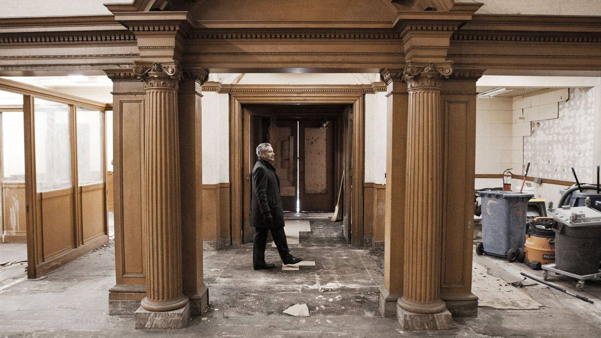 Gary Switzer studies the well-preserved carved woodwork. 'There's a lot of old buildings that were demolished in Toronto I wouldn't mind rebuilding, like the old post office on Adelaide,' he muses.