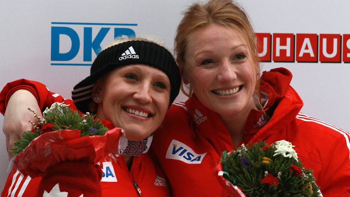 Pilot Kaillie Humphries (L) and Heather Moyse of Team Canada 1 celebrates after the final run of the women's Bobsleigh World Championship on February 19, 2011 in Koenigssee, Germany.