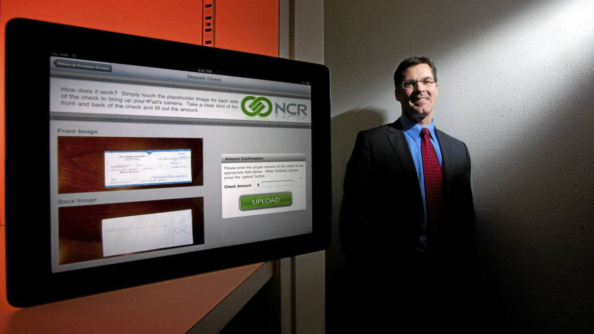 Steven Nogalo of NCR. Canadian banks are preparing to introduce new technology that will let you take a picture of a cheque using your cellphone and e-mail it directly to the bank to immediately collect the funds. The gadgetry needed to do this is made by NCR of Waterloo, Ont.