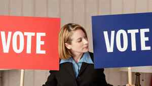 Politician holding Vote signs