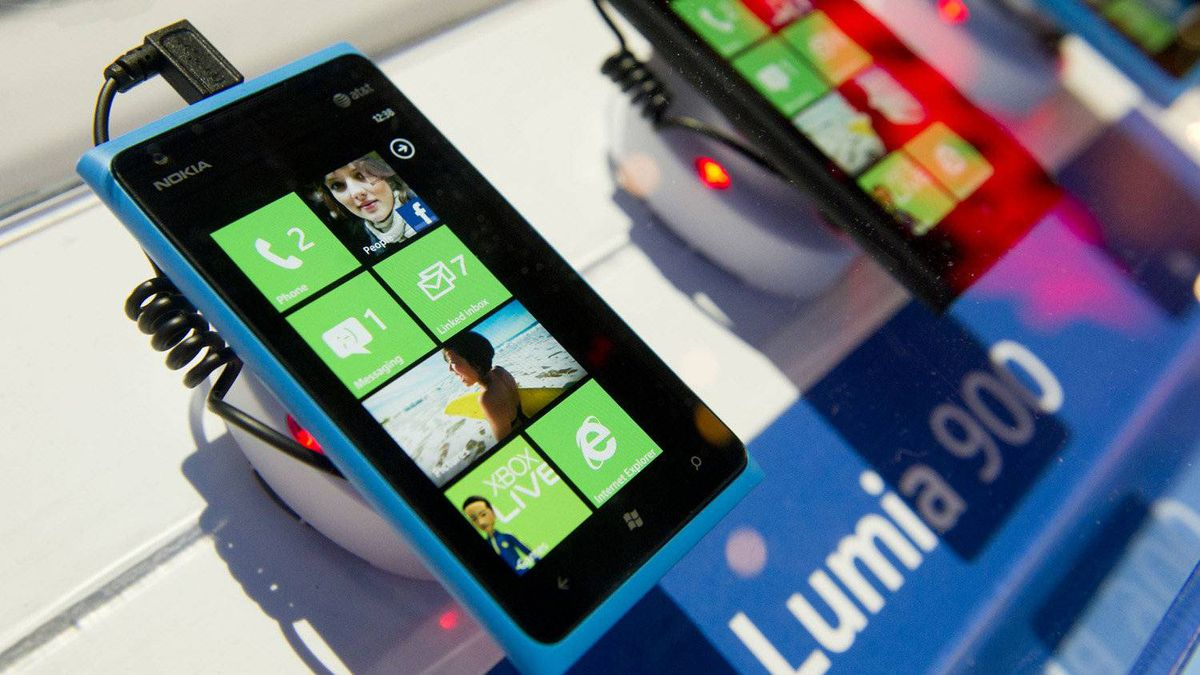 Nokia Oyj Lumia 900 smart phones sit on display during the 2012 International Consumer Electronics Show in Las Vegas, Nev., on Jan. 12, 2012.