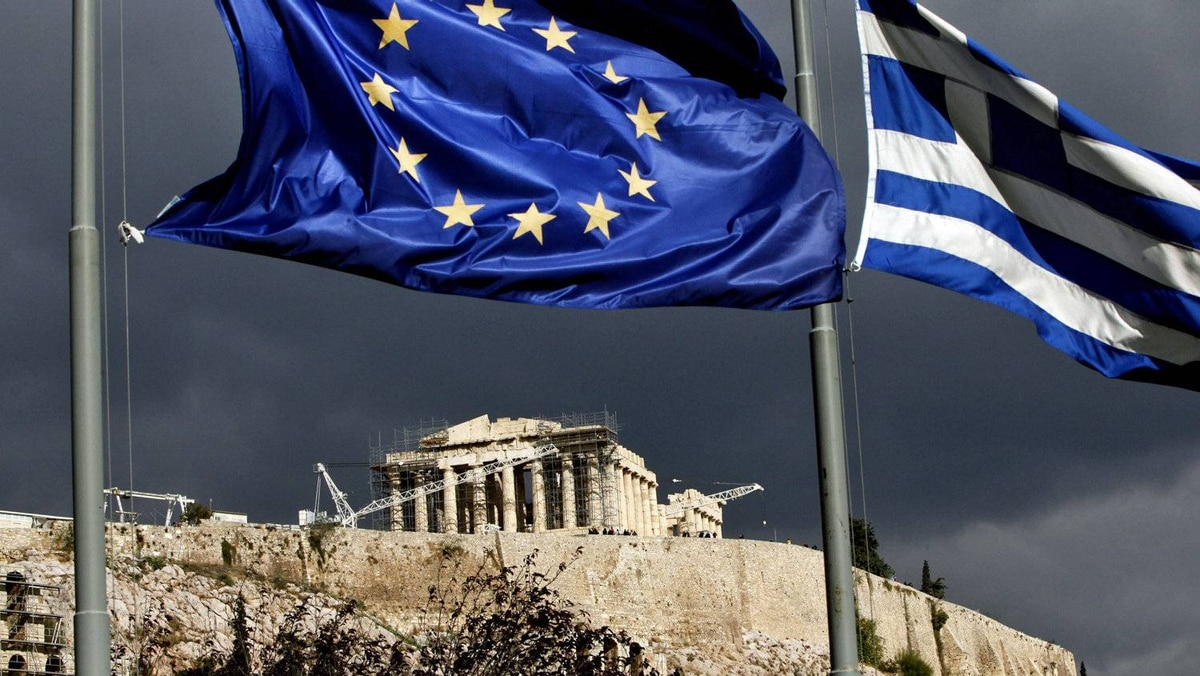 The European Union and Greek flags fly near the Parthenon in Athens on Oct. 31, 2011.