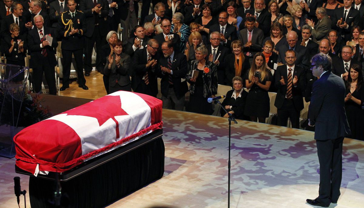 People applaud singer Steven Page after he performed at the state funeral of the late NDP leader Jack Layton.