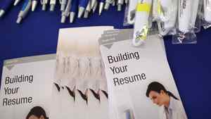 Free pens and resume building pamphlets are displayed during the Job Hunter's Boot Camp at College of San Mateo on June 7, 2011 in San Mateo, California.