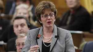 Human Resources Minister Diane Finley stands in the House of Commons during Question in Ottawa, Friday Feb. 10, 2012.
