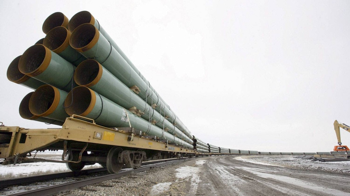 Rail cars loaded with pipe for the first Keystone pipeline sit on a siding in Milton, N.D., in February, 2008. TransCanada says it is only weeks from proposing an alternate route for Keystone XL through the ecologically sensitive Sand Hills in Nebraska.