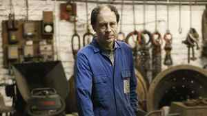 Mark Buckhouse stands infront of one of the Queen's diamond jubilee bells at the Whitechapel Bell Foundry.