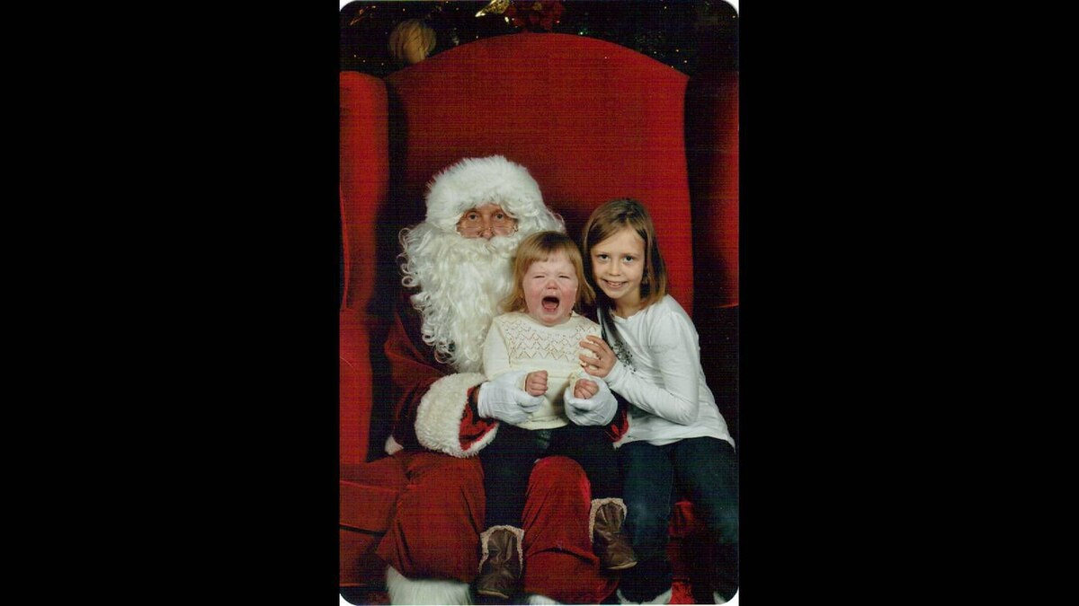Anne Fitzpatrick photo: Alison's first visit to Santa in 2009. She was alright until Mom walked away. Older sister Claire is a pro!