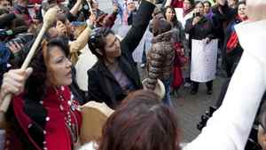 Women sing and chant outside of the missing women inquiry in downtown Vancouver, Tuesday, Oct. 11, 2011.