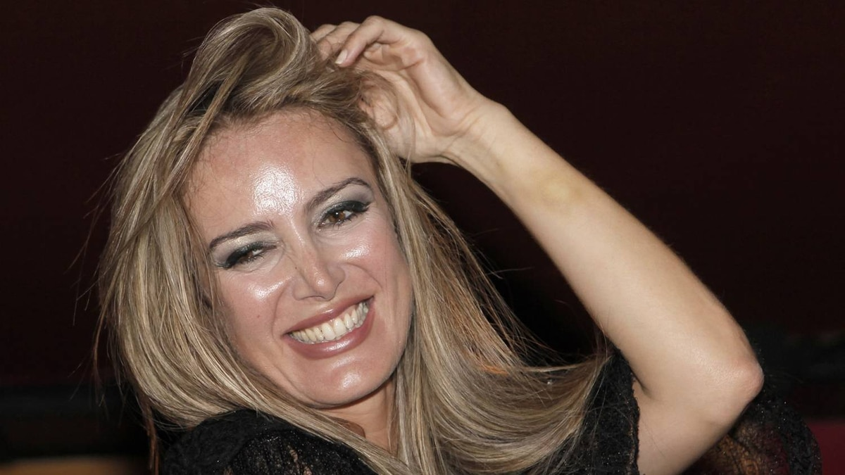 """In this Saturday Aug. 1, 2009 file photo, Italian escort Patrizia D'addario poses during an Italian style party named """"I love Silvio"""", in Paris. The prostitute at the center of Premier Silvio Berlusconi's sex scandal has written a book, saying she feels betrayed by him and has been frightened by threats, including the ransacking of her home. Patrizia D'Addario, whose memoir went on sale Tuesday, Nov. 24, 2009, in Italy, claims she has suffered """"strange'' threats since she revealed earlier this year that she had taped-recorded her purported bedroom encounter with Berlusconi. In """"Gradisca, Presidente, '' (At Your Pleasure, Premier), D'Addario elaborates on her earlier accounts of the night she spent with Berlusconi in his Rome residence."""