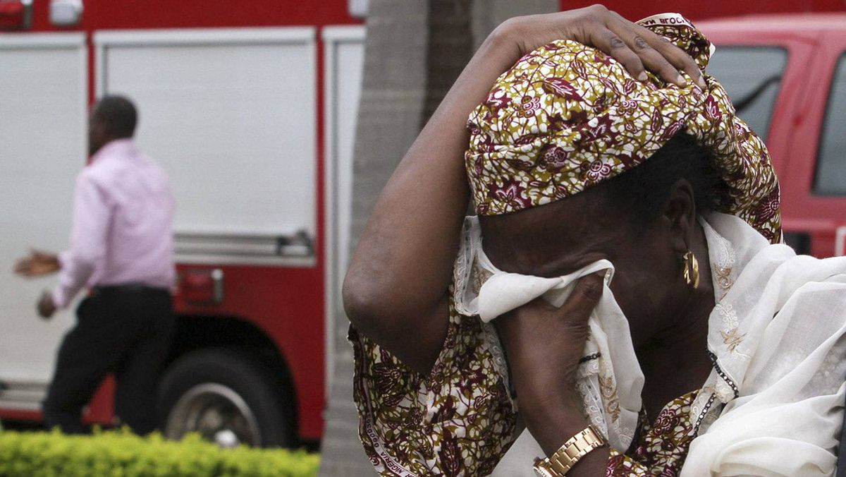 An unidentified victim weeps after a bomb blast that ripped through the United Nations offices in the Nigerian capital of Abuja August 26, 2011.