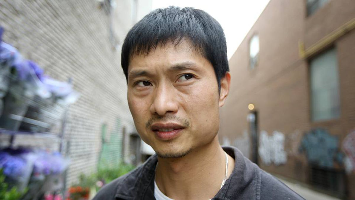 David Chen outside the grocery store he owns on Dundas Street in Toronto's Chinatown.