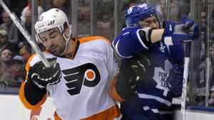 Toronto Maple Leafs forward Mikhail Grabovski is hit into the boards by Philadelphia Flyers defenceman Marc-Andre Bourdon (L) during the second period of their NHL hockey game in Toronto March 29, 2012.