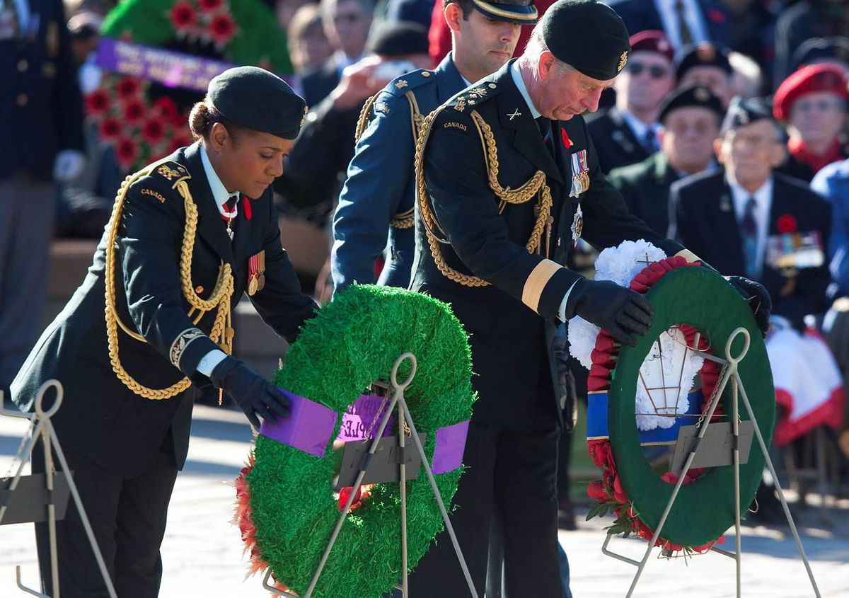 Governor-General Michaëlle Jean and Prince Charles lay wreaths during Remembrance Day services at the National War Memorial in Ottawa.