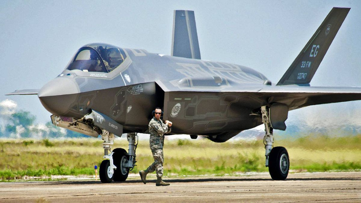 A maintenance worker checks a U.S. Air Force F-35 Lightning II fighter jet at Florida's Eglin Air Force on July 14, 2011.