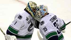 Vancouver Canucks goalie Roberto Luongo, left, is replaced by Vancouver Canucks goalie Cory Schneider after giving up three goals to the Boston Bruins during the first period of Game 6 of the Stanley Cup hockey final at the TD Garden in Boston, Monday, June 13, 2011.