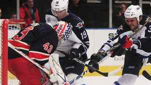 New York Rangers goalie Martin Biron (43) protects the goal from Winnipeg Jets' Dustin Byfuglien (33) and Jim Slater (19) during the first period of an NHL hockey game, Sunday, Nov. 6, 2011, in New York. (AP Photo/Frank Franklin II)