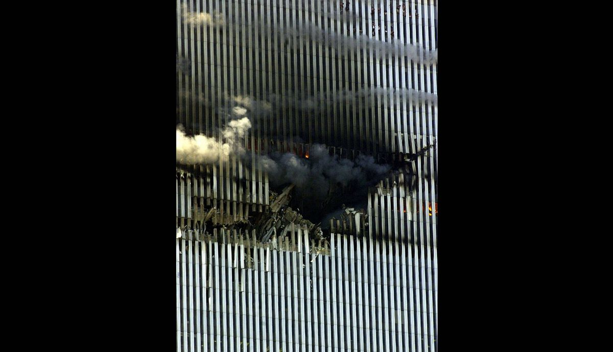 This photo shows the point of impact where a plane crashed into the north tower of the World Trade Center in New York City early September 11, 2001.
