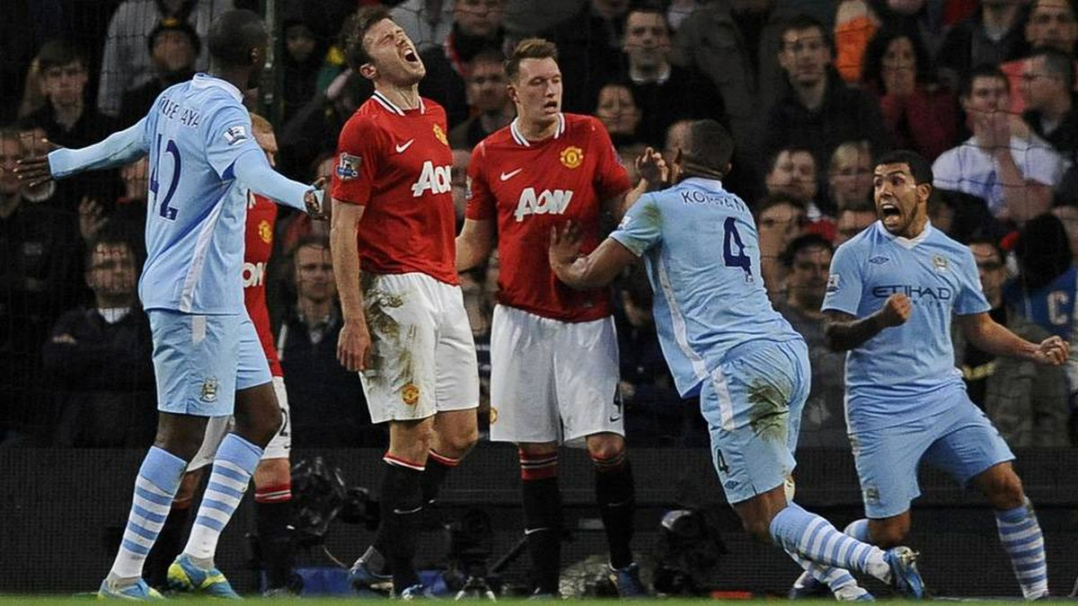 Manchester City's Vincent Kompany reacts with team mate Carlos Tevez after scoring during their English Premier League soccer match against Manchester United.