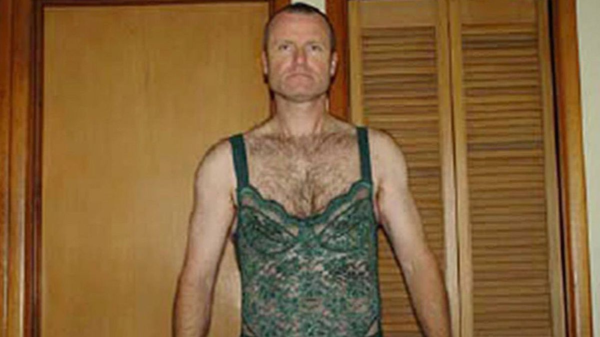 Col. Russel Williams is seen wearing women's lingerie in this court released photo on Monday Oct. 18, 2010.