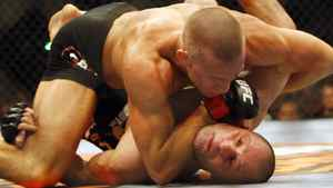 Georges St-Pierre, top, from Montreal gets on top of Matt Serra, from Long Island, NY, during their Ultimate Fight Championships Welterweight title fight in Montreal, Saturday April 19, 2008. St-Pierre won the match with a second round TKO. THE CANADIAN PRESS/Ryan Remiorz