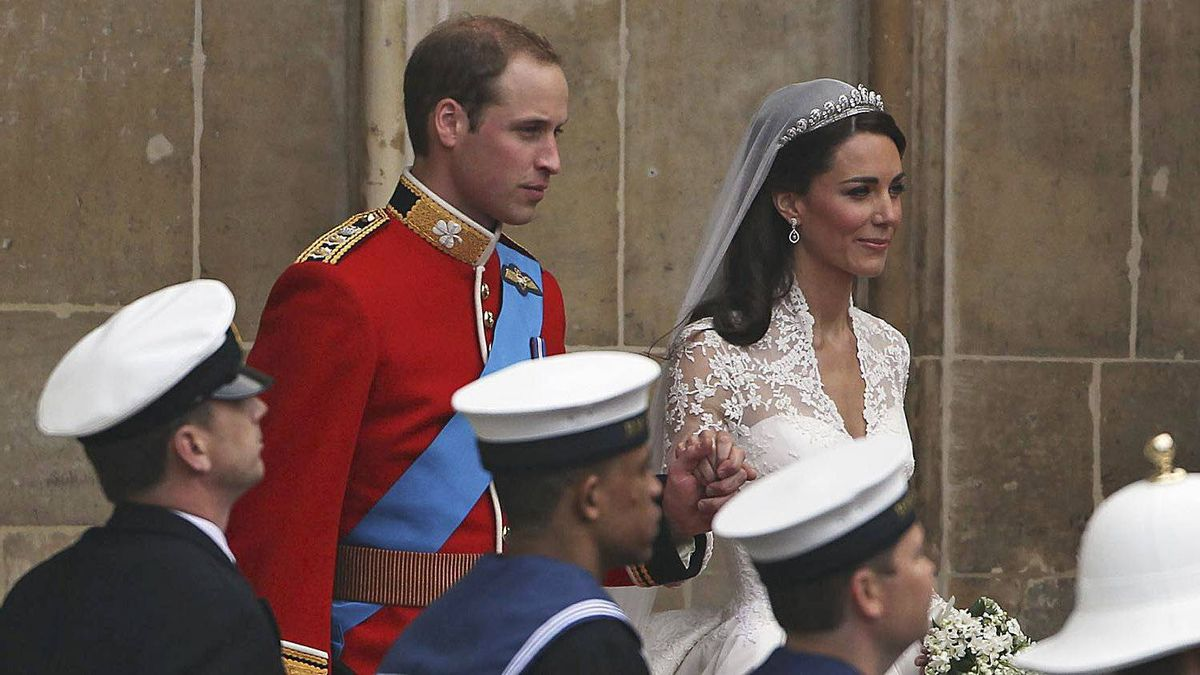 Prince William and Princess Catherine make the journey by carriage procession to Buckingham Palace following their marriage at Westminster Abbey on April 29, 2011 in London, England.